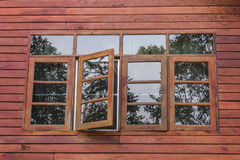 Just open. Vintage wood window open with reflex of mirror Stock Images