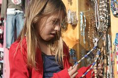 Just Out Shopping. Little girl out shopping for trinkets and babbles Royalty Free Stock Photo