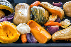 Just from the oven roasted pumpkin, garlic, onion, carrot Royalty Free Stock Photos