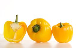 Just peppers, you know. Fresh glossy tastefull peppers over white background Royalty Free Stock Photography