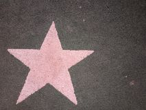 Just a pink star on the ground royalty free stock images