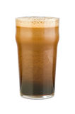 Just poured stout beer. Just poured black stout beer with a rich avalanche scum in a classical pint glass. Isolated on white. Isolated by clipping-path Stock Photos