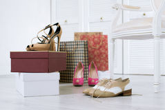 Just purchased shoes. Three pairs of just purchased and unboxed shoes on a floor of a wardrobe Royalty Free Stock Photo