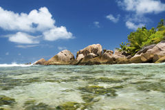 Just Relax Inside the water at Anse Coco at La Digue Stock Images