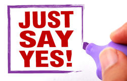 Just say yes. Text is signed by marker on white paper Royalty Free Stock Photography