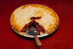 Serving up the traditional holiday cherry pie Royalty Free Stock Photo