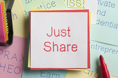 Just Share written on a note Stock Photo