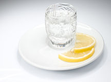 Just a shot of vodka. With lemon slices Stock Photo