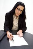 Just Sign Please. Women holding pen pointing to blank document Royalty Free Stock Photos