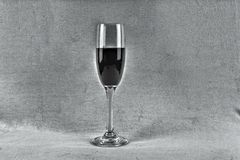 Just a sip. An glass of wine on a effect background Royalty Free Stock Photo