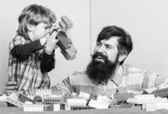 Just smile. building plane with constructor. small boy with dad playing together. happy family leisure. love. child stock photography
