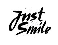 Just smile.Hand drawn  calligraphic sign Inspirational quote art. Vector lettering illustration for you design. Stock Image