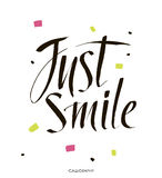 Just smile.Hand drawn vector calligraphic sign Inspirational quote art. Vector lettering illustration for you design. Stock Photo