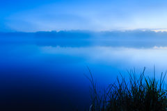 Just before sunrise lake France Royalty Free Stock Image