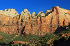 Altar of Sacrifice and West Temple at Sunrise, Zion National Park, Utah. Just after sunrise the morning light is illuminating the sheer cliffs of the West Temple royalty free stock photos