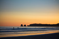 Just before sunrise of silhouette deux jumeaux in summer sky on a sandy beach Stock Image