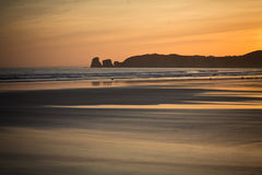 Just before sunrise silhouette of deux jumeaux in summer sky on a sandy beach Royalty Free Stock Images