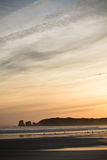 Just before sunrise silhouette of deux jumeaux in summer sky on a sandy beach Royalty Free Stock Photography