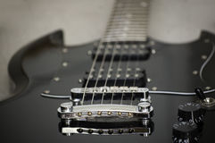 Just To Rock And Roll. Picture of a black electric guitar from the bridge to the neck Stock Photo
