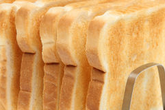 Just Toast. Six slices of toast in a rack. Shallow DoF. Focus on edge of nearest slice Stock Images
