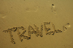 Just travel. Travel written in the sand Royalty Free Stock Images