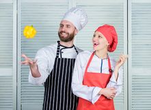 Just try. Woman and bearded man cooking together. Cooking healthy food. Fresh vegetarian healthy food recipe. Fresh stock photography