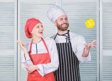 Just try. Woman and bearded man cooking together. Cooking healthy food. Fresh vegetarian healthy food recipe. Fresh royalty free stock images