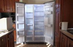 Just Unpacked New Refrigerator with Empty Shelves Stock Images