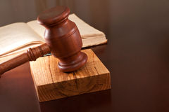 Just verdict. Open book of laws and gavel on the table Royalty Free Stock Image