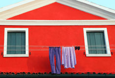 Just washed laundry hung out to dry in the House in Italy Stock Image