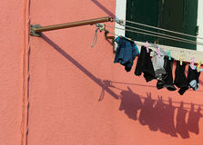 Just washed laundry and lots of clothes hung out to dry Royalty Free Stock Photo