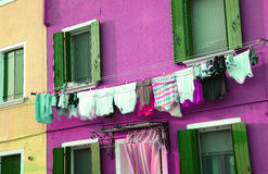 Just washed laundry and lots of clothes hung out to dry Royalty Free Stock Image