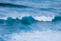 Just a wave in an ocean. Single wave plunging. Natural blue water. Barwon Heads, Victoria, Australia. Single wave, powerful and strong Royalty Free Stock Image