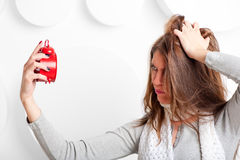 Just woken up girl angry alarm clock Stock Images