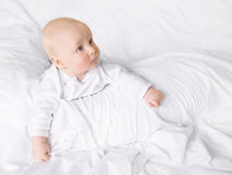 Just wondering... Cute baby on white blankets Royalty Free Stock Images