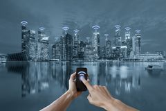 Hands holding smartphone and cityscape wifi network concept. Just you have internet you can communicate with everyone in the world royalty free illustration