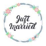 Juste lettrage marié avec la guirlande florale Image libre de droits