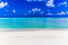 Juste Married écrit sur le sable Photographie stock