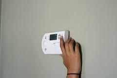 justering av temperatur Arkivfoton