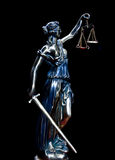 Justice. Statue of justice on a black background Royalty Free Stock Image