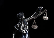 Justice. Statue of justice on a black background Royalty Free Stock Images