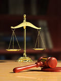 Justice. Scale and wood gavel, bookshelf visible on background. Digital illustration Stock Photos