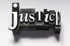 Justice. The word Justice photographed using vintage type characters. Cross-proccessed for a unique look Royalty Free Stock Images