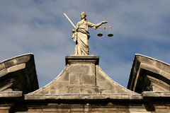 Justice. Statue of Justice on Dublin Castle wall Stock Image