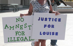 Justice, amnesty signs. Justice for Louise, No Amnesty for Illegals Royalty Free Stock Image