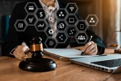 Free Justice And Law Concept. Female Judge In A Courtroom With The Gavel Working With Digital Tablet Compute. Royalty Free Stock Photo - 156612815