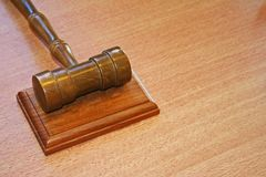 Justice background. Court table with metal hammer stock photos