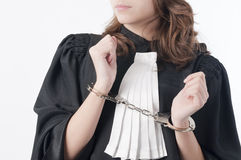 Justice is blind. Young law school student holding statute books blindfolded and handcuffed Stock Images