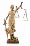 Justice is blind ( ... or maybe not ). Justice (greek:themis,latin:justitia) blindfolded with scales and sword royalty free stock photography