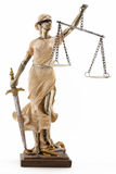 Justice is blind ( ... or maybe not ). Justice (greek:themis,latin:justitia) blindfolded with scales and sword stock photography